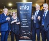 Legal firm hosts merger reception